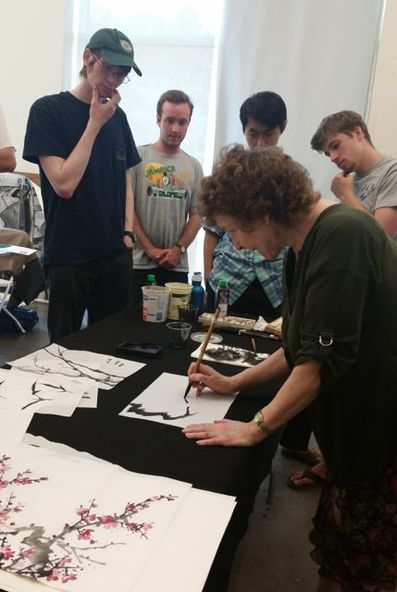 Picture of artist demonstrating plum branch on rice paper