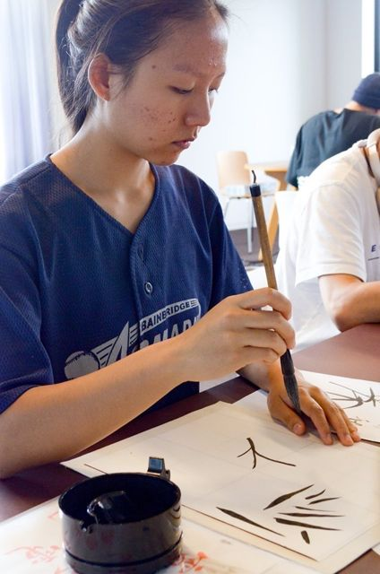 Picture Japanese student with brush