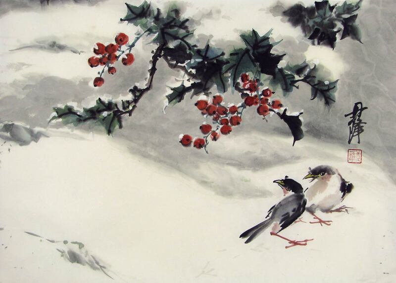 holly with red berries and two birds in the snow